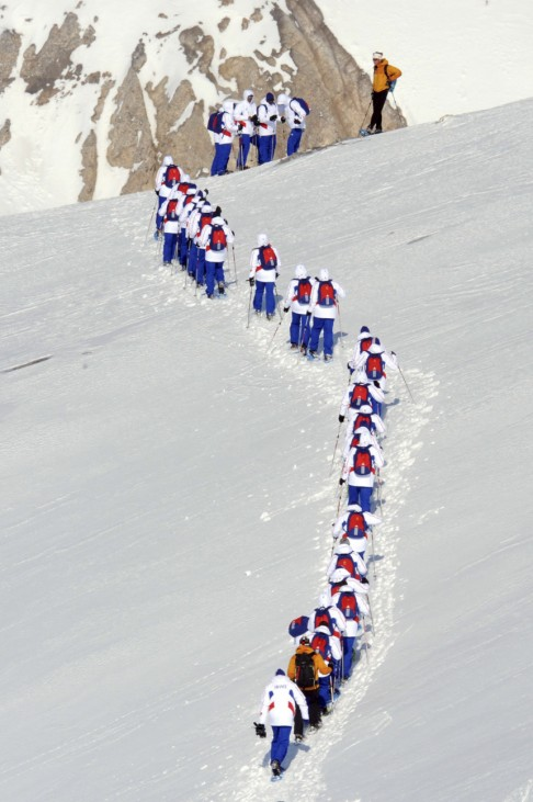 French soccer players walk in the snow in the French Alps resort of Tignes
