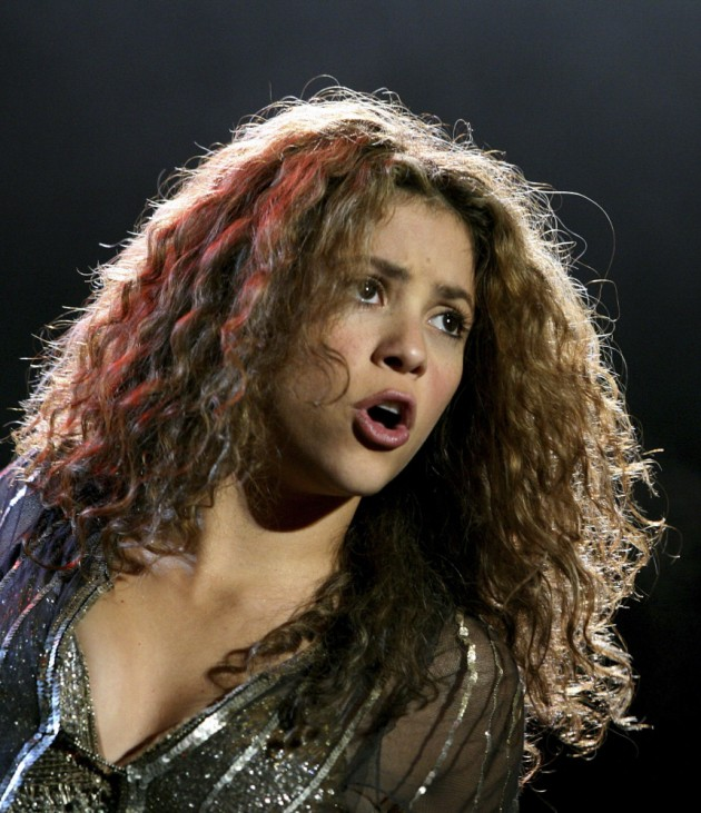 Colombian pop star Shakira performs during her concert in Bogota