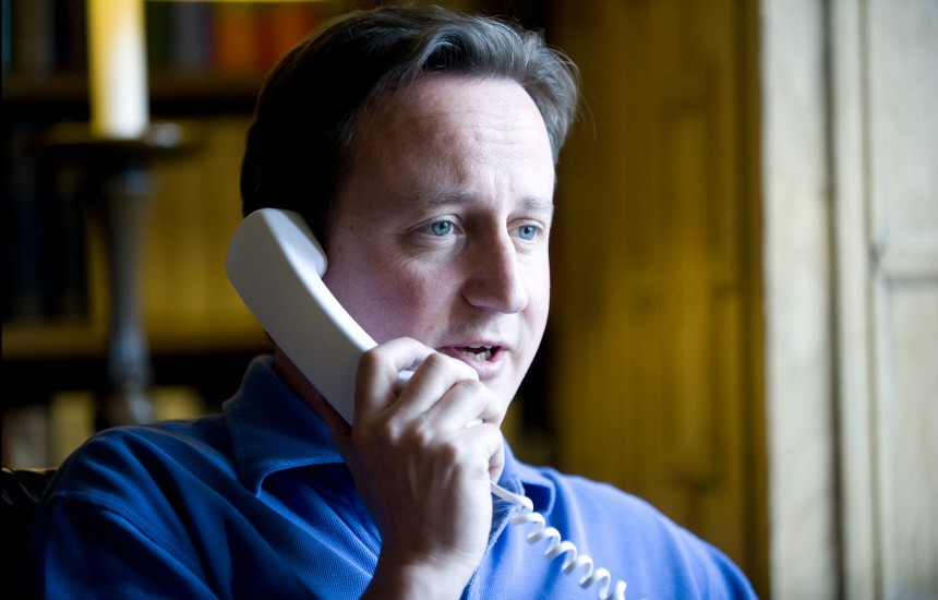 Britain's PM Cameron talks to U.S. President Obama on the phone in his office at his official country residence of Chequers outside London