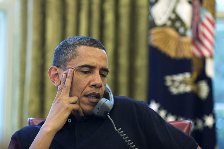 U.S. President Obama talks on the phone with Britain's Prime Minister Cameron in the Oval Office of the White House in Washington, DC
