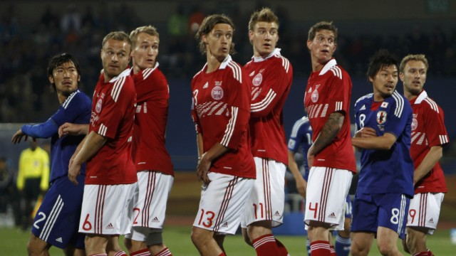 Denmark's players watch as the free kick from  Japan's Yasuhito Endo enters the goal during their 2010 World Cup Group E soccer match at Royal Bafokeng stadium in Rustenburg