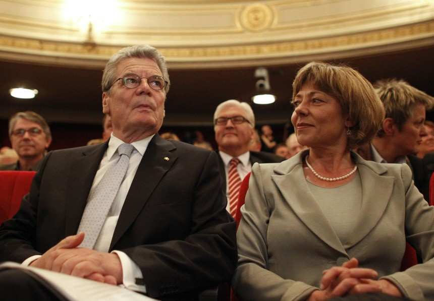 German presidential candidate Joachim Gauck sits next to his partner Daniela Schadt before his speech in Berlin