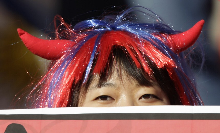 A fan waits for the start of the 2010 World Cup second round match between Uruguay and South Korea in Port Elizabeth