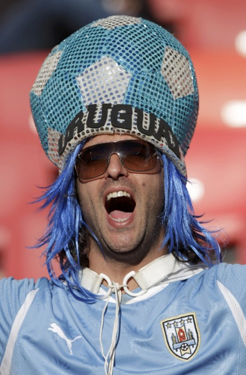 A fan cheers before the 2010 World Cup second round match between Uruguay and South Korea in Port Elizabeth