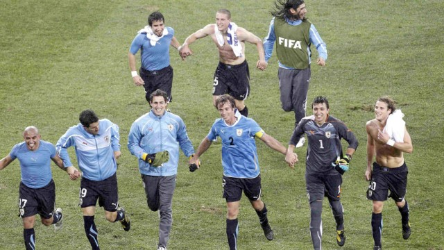 Uruguay players celebrate as they leave the pitch after their 2010 World Cup second round match in Port Elizabeth
