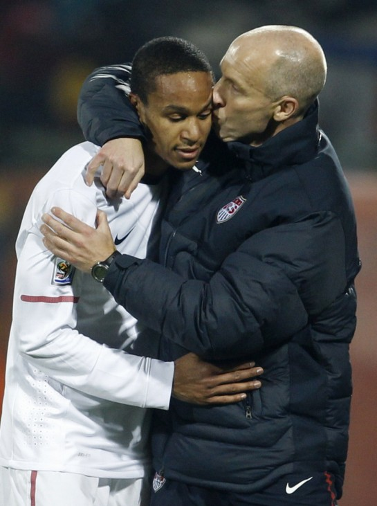 United States coach Bob Bradley greets Ricardo Clark after he was substituted during the 2010 World Cup second round match against Ghana at Royal Bafokeng stadium in Rustenburg
