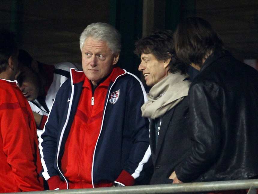 Musician Jagger and former U.S. President Clinton watch the 2010 World Cup second round match between the United States and Ghana in Rustenburg