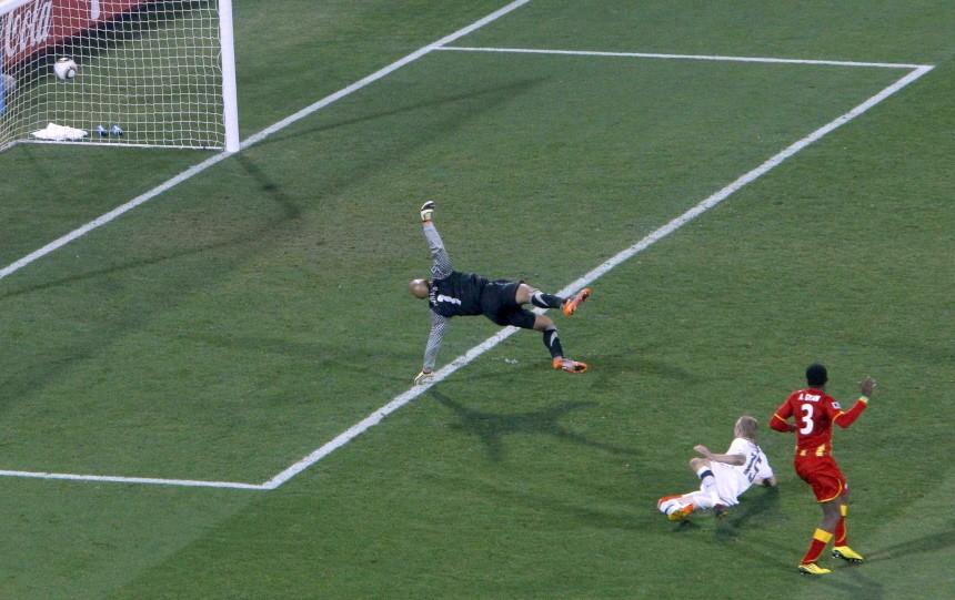 Ghana's Asamoah Gyan scores a goal past United States goalkeeper Tim Howard at Royal Bafokeng stadium