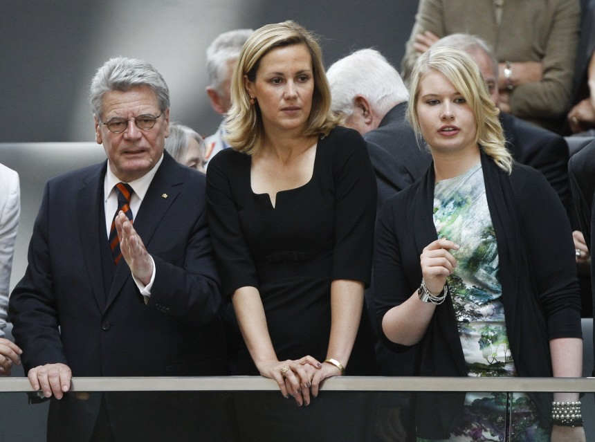 Presidential candidate Gauck, gestures next to Bettina Wulff, wife of presidential candidate Wulff, in Berlin