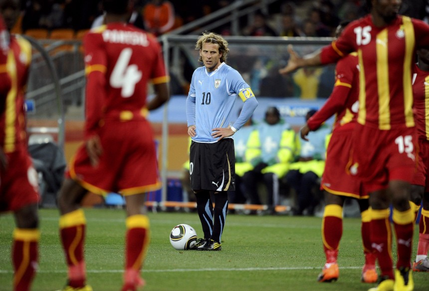 Uruguay's Forlan prepares to take a freekick against Ghana during a 2010 World Cup quarter-final soccer match at Soccer City stadium in Johannesburg