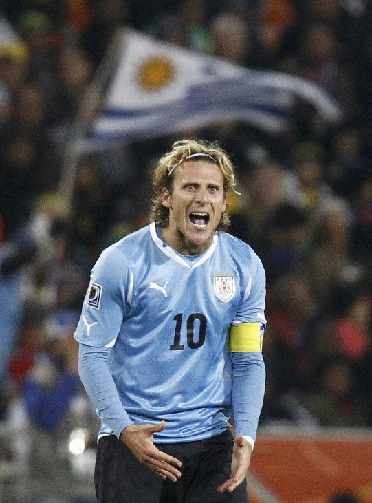 Uruguay's Diego Forlan celebrates his goal during the 2010 World Cup quarter-final soccer match against Ghana at Soccer City stadium in Johannesburg
