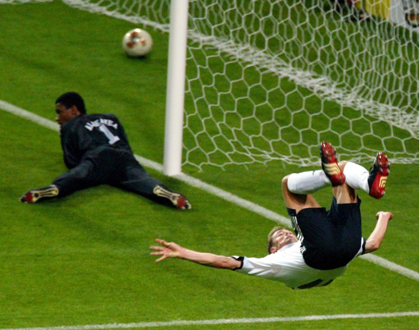 GERMANY'S KLOSE SOMERSAULTS AFTER SCORING DURING THEIR WORLD CUP FINALS MATCH AGAINST SAUDI ARABIA IN SAPPORO