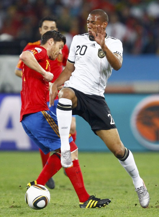 Spain's Xabi Alonso fights for the ball with Germany's Jerome Boateng during their 2010 World Cup semi-final soccer match at Moses Mabhida stadium