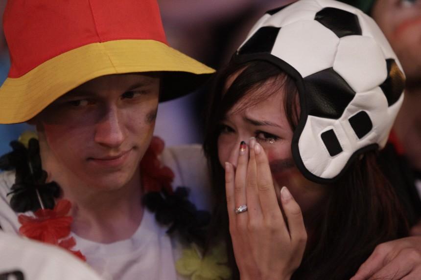 Soccer fans react during screening of 2010 World Cup semi-final soccer match match in Berlin