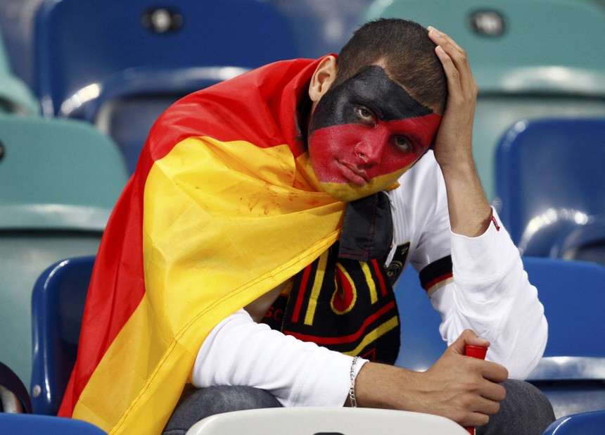 A Germany fan reacts after their 2010 World Cup semi-final soccer match against Spain at Moses Mabhida stadium in Durban