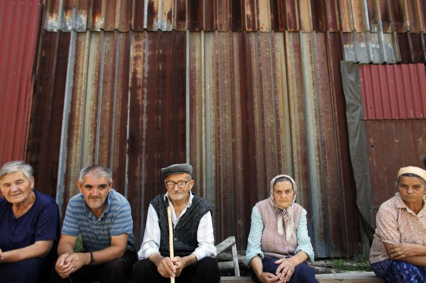 Bosnian refugees wait for a U.N. delegation to visit their collective center in Srebrenica