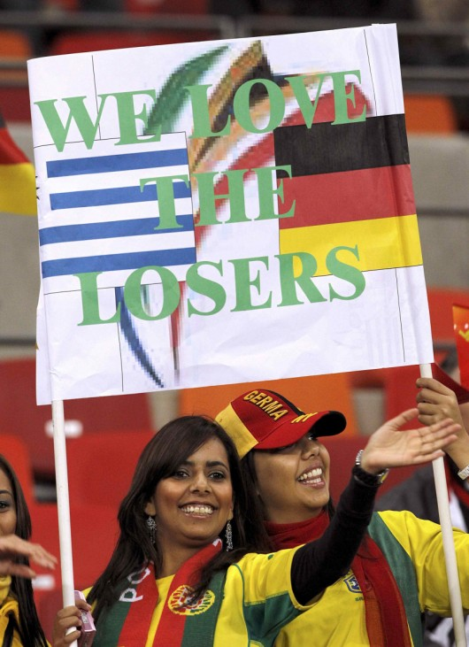 Fans hold up a sign as they wait for the start of the 2010 World Cup third place playoff soccer match in Port Elizabeth