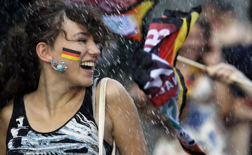 A soccer fan smiles before a screening of the 2010 World Cup third-place play-off soccer match between Germany and Uruguay at the 'Fan mile' public viewing area in Berlin