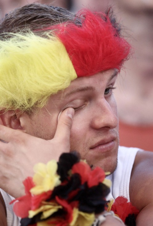 A soccer fan reacts during screening of the 2010 World Cup third-place play-off soccer match between Germany and Uruguay
