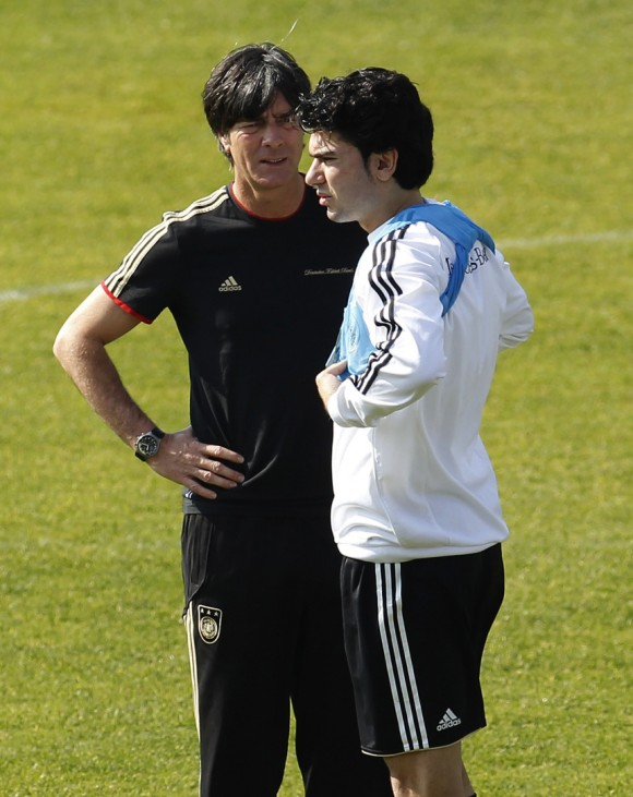 Germany's coach Loew talks to Tasci during a training session in Pretoria