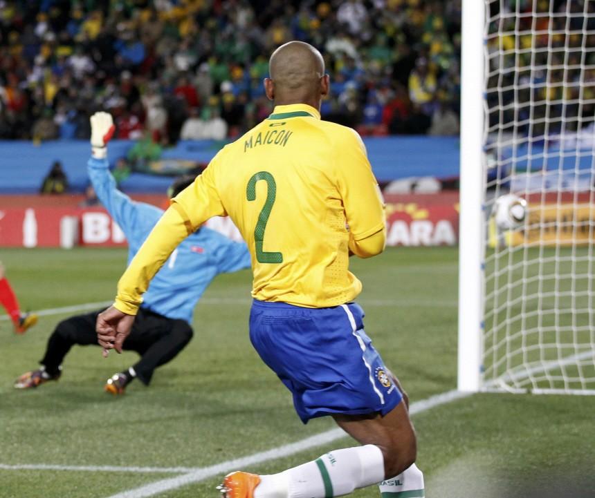 Brazil's Maicon (2) scores past North Korea's goalkeeper Ri Myong-guk during a 2010 World Cup Group G soccer match at Ellis Park stadium in Johannesburg