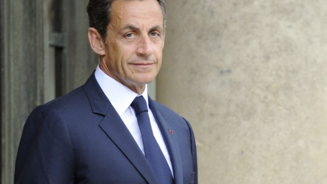 France's President Sarkozy waits for Morocco's Prime Minister El Fassi at the Elysee Palace in Paris