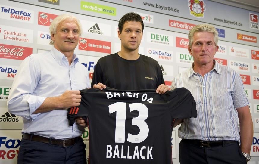 Germany's national soccer captain Ballack Bayer Leverkusen coach Heynckes and manager Voeller hold news conference in Leverkusen