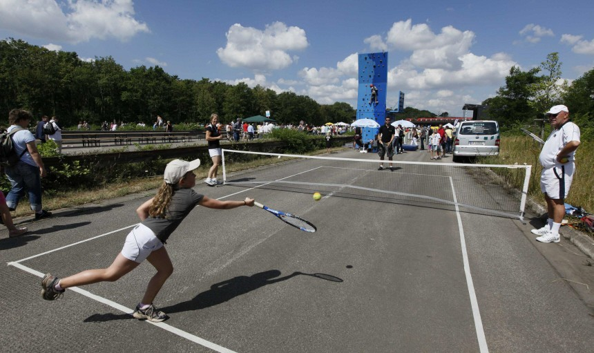 A girl plays tennis on the 60 km (38 miles) long A40/B1 motorway between the western German cities of Dortmund and Duisburg