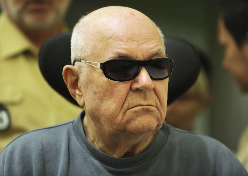 Accused Nazi death camp guard John Demjanjuk arrives in a courtroom in Munich
