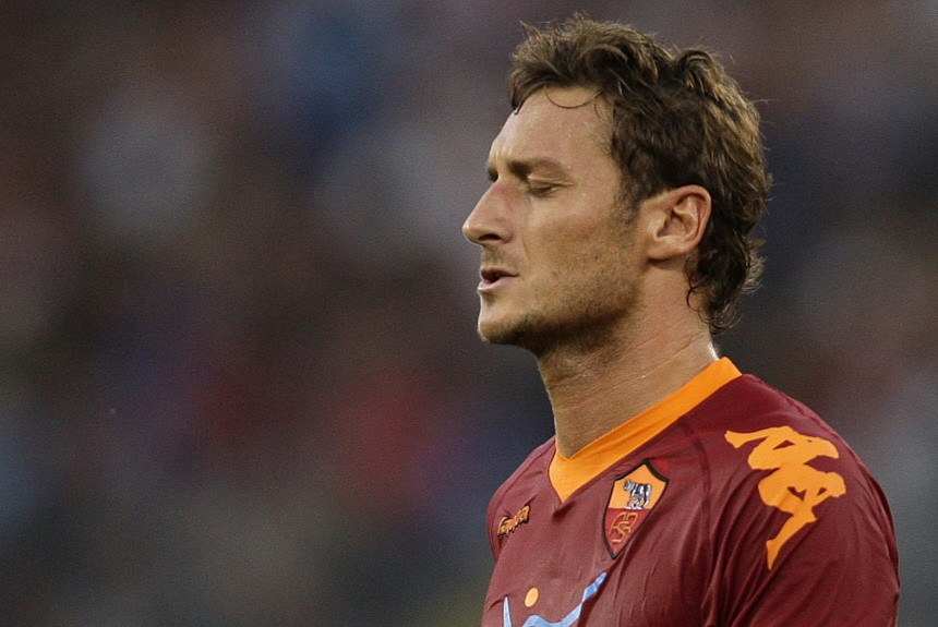 AS Roma's Totti reacts after missing a goal during the Italian Serie A soccer match against Juventus at the Olympic stadium in Rome