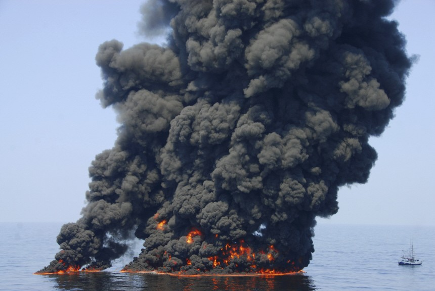 Handout shows smoke billowing from a controlled burn of spilled oil off the Louisiana coast in the Gulf of Mexico