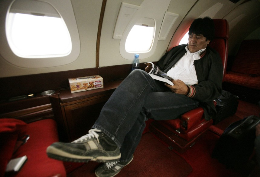 Bolivian President Evo Morales reads a book during his trip to Sucre in the presidential aircraft