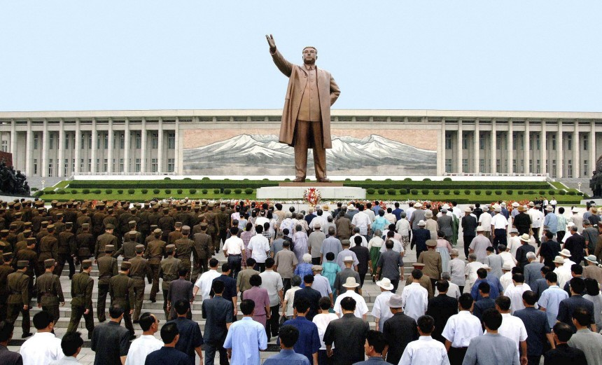 North Korean soldiers, workers and students walk to offer flowers in front of the statue of Kim Il-Sung in Pyongyang