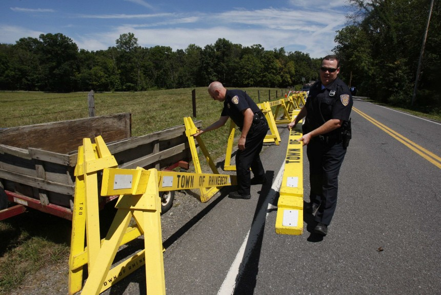 Police set up a barricade for the media along a road in the town of Rhinebeck where Clinton is believed to be getting married