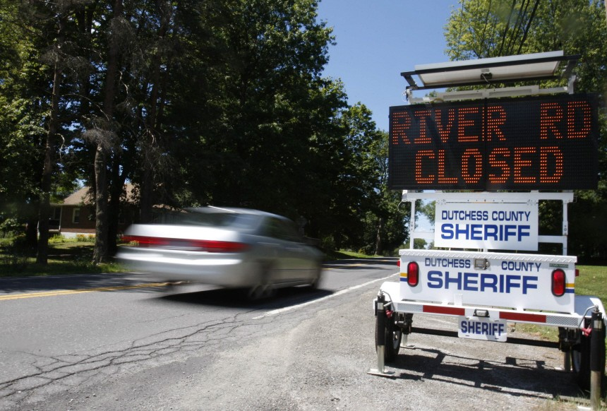 A sign for a road closure is seen along a street near where Clinton is getting married in Rhinebeck