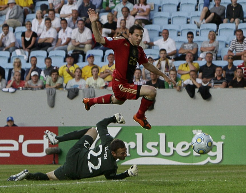 Germany's Castro scores over England's goalkeeper Loach during their U21 European Championship final soccer match at Malmo New Stadium in Malmo