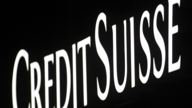 A logo is seen on the facade of a Swiss bank Credit Suisse agency in Zurich