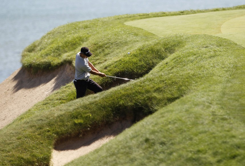 Martin Kaymer hits from a bunker on the third hole during the final round of the 92nd PGA Golf Championship at Whistling Straits