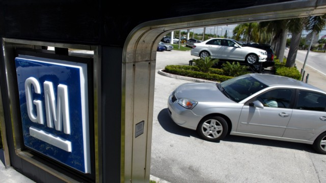 A woman drives a Chevrolet car into a GM dealership in Miami