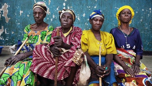 War displaced women sit together in eastern Congo