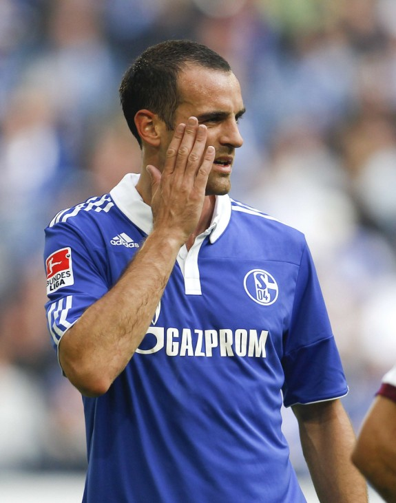 Schalke's Metzelder reacts during the German Bundesliga soccer match against Hanover in Gelsenkirchen