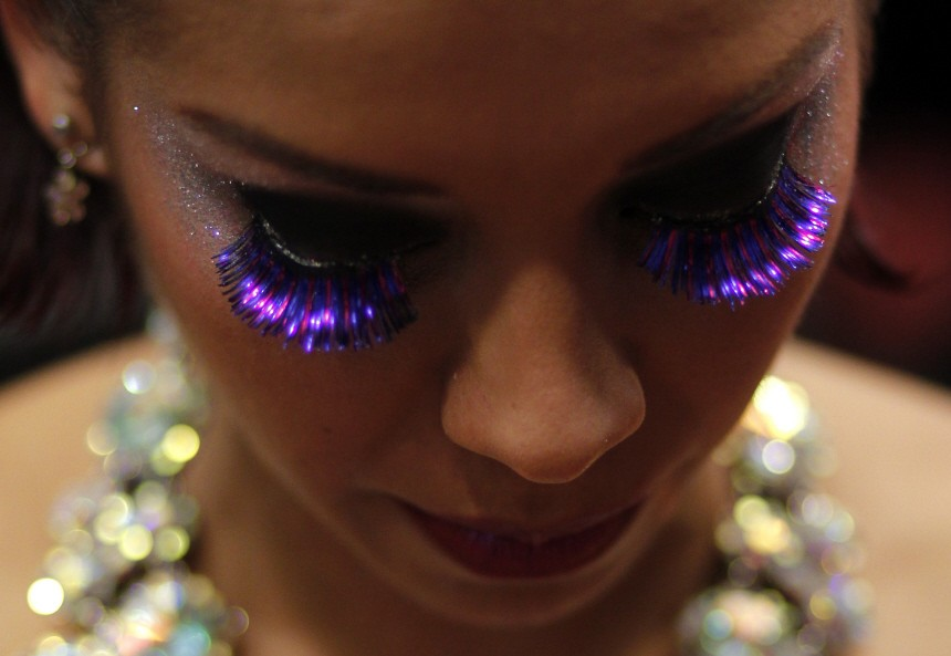Tango dancer Vargas of Colombia wearing fake eyelashes waits backstage before competing in the Tango Dance World Championship in Buenos Aires