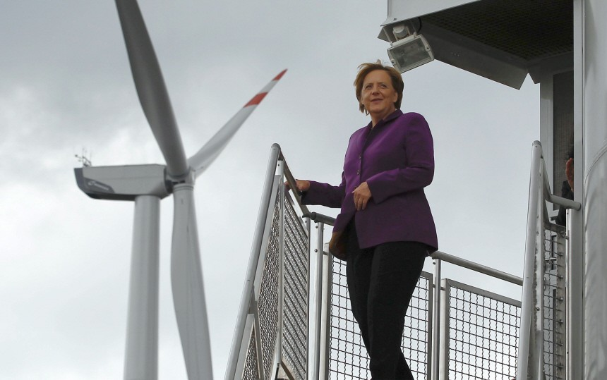 German Chancellor Merkel poses as she visits a wind turbine park 'WIND-projekt' in Ravensberg