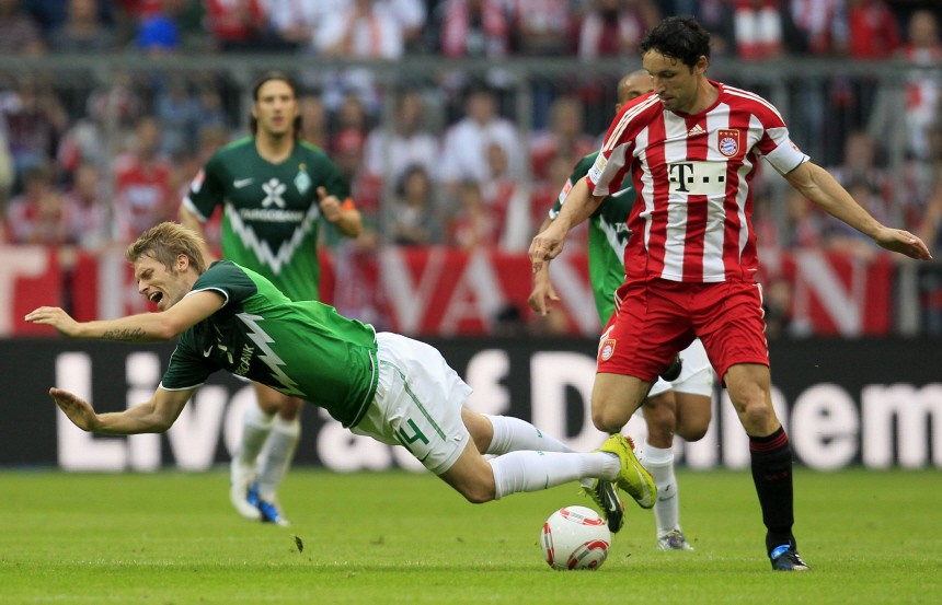 Bremen's Hunt is tackled by Bayern's van Bommel during their German first division Bundesliga soccer match in Munich