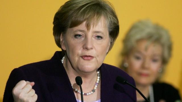Steinbach listens to the speech of CDU leader and German Chancellor-designate Merkel in Berlin